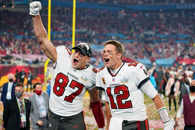 Tampa Bay Buccaneers tight end Rob Gronkowski and quarterback Tom Brady rejoice in victory over the Kansas City Chiefs in the 55th Super Bowl on Sunday night.