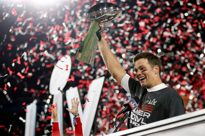 Tom Brady holds the Vince Lombardi Trophy aloft after his Tampa Bay Buccaneers defeated the Kansas City Chiefs in the 55th Super Bowl on Sunday night.