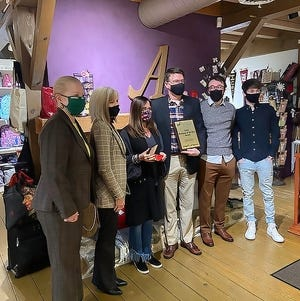 From left, Mayor Ann Womer Benjamin, Aurora Chamber of Commerce Board Prsident Laura Radcliff, Abigail's Owner Julie Lazor, her husband John Lazor, and sons Ben and Trevor were on hand when Abigail's was presented with the 2020 Business of the Year Award recently.