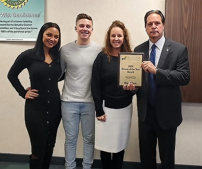 Aurora Person of the Year for 2020 Pete Elliott, right, celebrates the honor with his family, from left, Mary and Jake and his wife, Zena Elliott.
