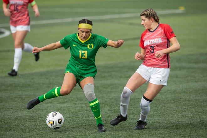 Oregon's Mia Palmer (13) tries to get past Gonzaga's Lauren Elwer in the Ducks' 1-0 win on Feb. 7.