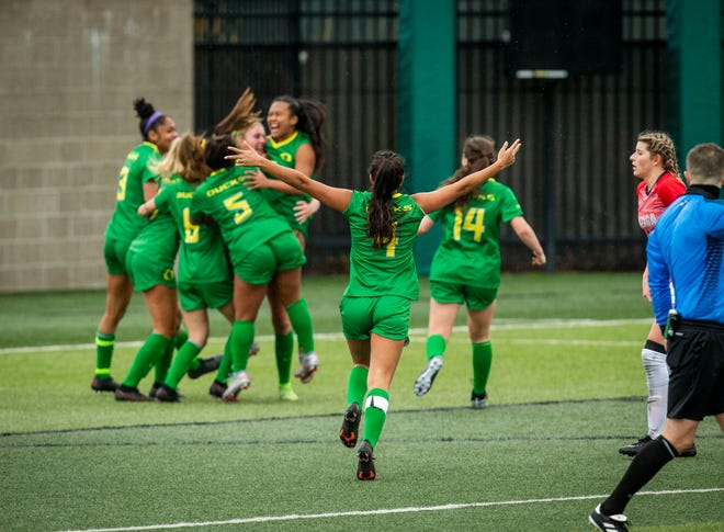 Chardonnay Curran (4) runs with her arms open to her teammates after scoring the winning goal. University of Oregon Ducks women soccer players face off Gonzaga University from Washington in season opener Sunday, Feb. 7, 2021