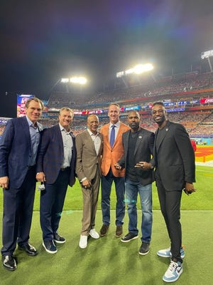 Six members of the Pro Football Hall of Fame's Class of 2021 — (from left) Alan Faneca, John Lynch, Drew Pearson, Peyton Manning, Charles Woodson and Calvin Johnson — pose for a photo on the field at Super Bowl 55, Sunday, Feb. 7, in Tampa. Fla. The Class of 2021 also features Tom Flores, who did not travel to Tampa, and the late Bill Nunn.