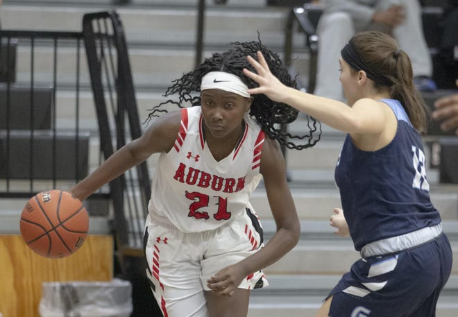 Zhakyla Evans, shown dribbling past a defender on Jan. 14, 2020, against Guilford, is one of three returning starters from an Auburn team that set a school record for wins and won its first conference title last season.