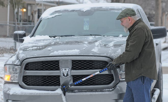 "Mick McDermott, of Salina, brushes off the snow on the front of his truck as his truck motor warms up with the temperature at eight-degrees on Monday morning at his residence on the 600 block of N 13th street. ""I came to Kansas from Alaska as my dad was in the military. The only difference between this weather and the weather in Alaska is the temperature in Alaska never got warm enough to melt the snow. The weather feels colder here than in Alaska. I can remember as a kid in Alaska it was 40 degrees below and it did not feel as cold as our 20-degree weather here,"" said McDermott."