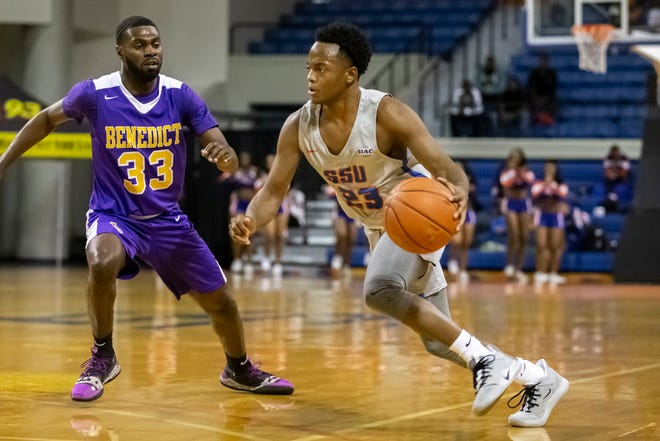Savannah State guard Marcus Scott (23) drives against Benedict College at Tiger Arena on Jan. 25, 2020, in Savannah.