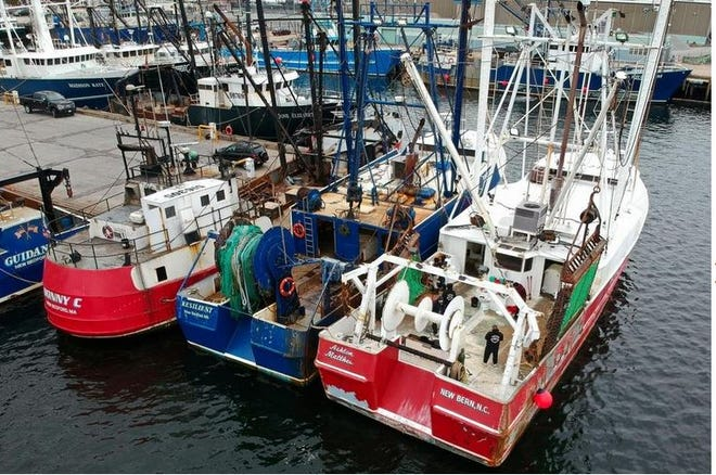 Fishing vessels docked in New Bedford Harbor.