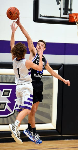 Collins-Maxwell's Mason Markley goes up to block a shot by Baxter's Rory Heer during the Spartans' 80-75 overtime loss to the Bolts Feb. 2 at Baxter.