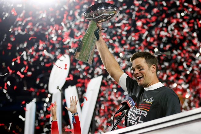 Tampa Bay Buccaneers quarterback Tom Brady holds the Vince Lombardi trophy following the Super Bowl.
