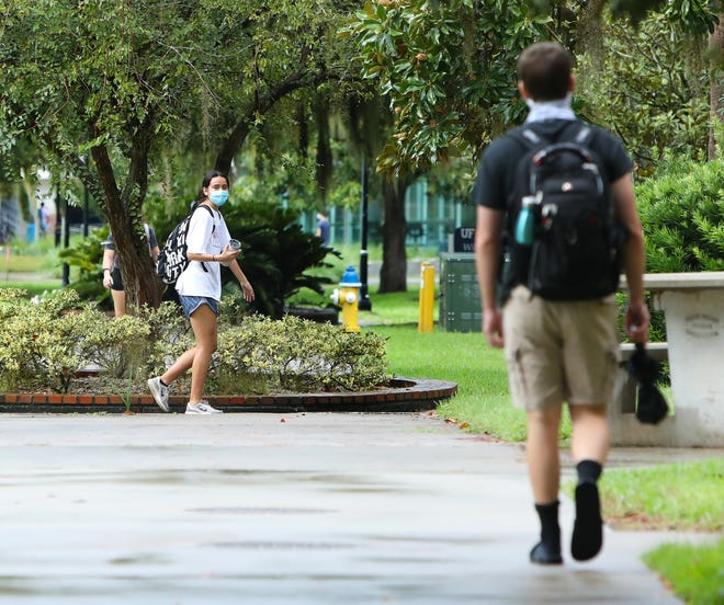 Students walk around the University of Florida campus as the first day of fall classes begin at the school on Aug. 31, 2020.