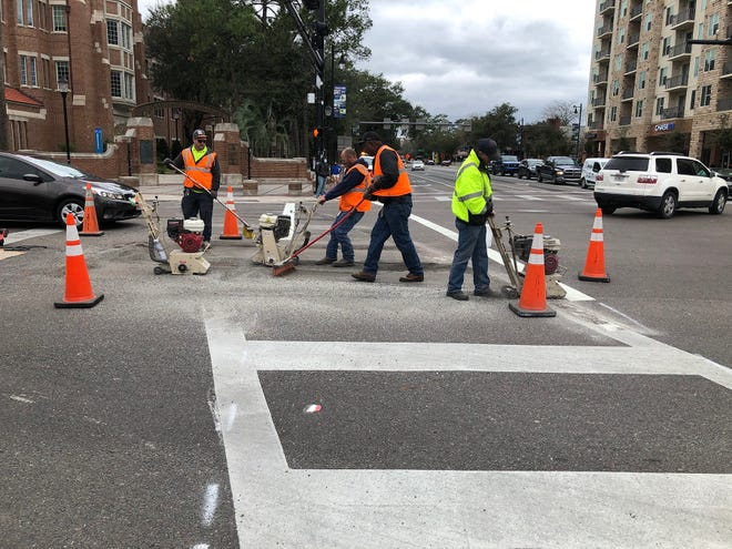 Workers realign the crosswalk at University Avenue and 13th Street in Gainesville as part of the Florida Department of Transportation's efforts to improve pedestrian safety in the area. [Florida Department of Transportation]