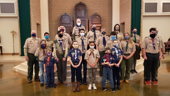 Scouts from Troop and Pack 9 recently attended Scout Sunday services to show reverence to God. Reverence is the 12th point of the Scout Law. The Scouts received a blessing from the presiding friar. Scout Lane McEwan received his Par Veuli Dei Catholic Program award for Cub Scouts.