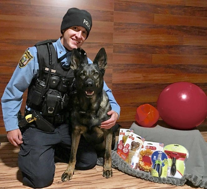 Dogs 4 Warriors is alleged to have sold this dog to the Barnesville Police Department, which was donated to the Bowerston-based organization to be trained as a service dog for a veteran.  Barnesville Police Officer Andrew Stewart is shown with Dixie, who has since retired.