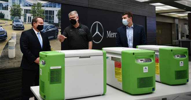 Michael Goebel, center, Mercedes-Benz U.S. International's president and CEO, announces the donation of freezers to the Alabama Department of Public Health on Friday at the Vance-based plant. At left is Tuscaloosa County Probate Judge Rob Robertson and at right is Tuscaloosa Mayor Walt Maddox. [Submitted photo]