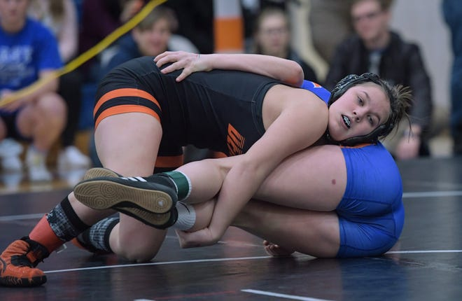 Kelcey Dew and the Delaware Hayes girls wrestling team compete in the district tournament Feb. 14 at Olentangy Orange. Last year in the inaugural girls state tournament, Dew finished third at 121 pounds.