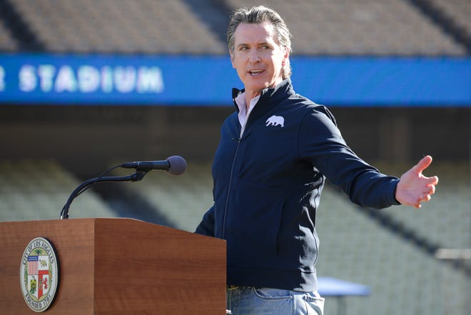 In this Jan. 15, 2021, file photo, Gov. Gavin Newsom addresses a press conference held at the launch of a mass COVID-19 vaccination site at Dodger Stadium in Los Angeles.
