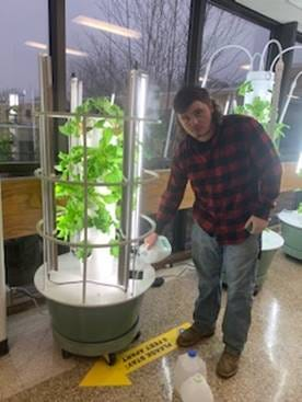 Kyle Canfield, Scio Central School Science Teacher, also spearheads the Tower Gardens project, seen here with an SCS student.