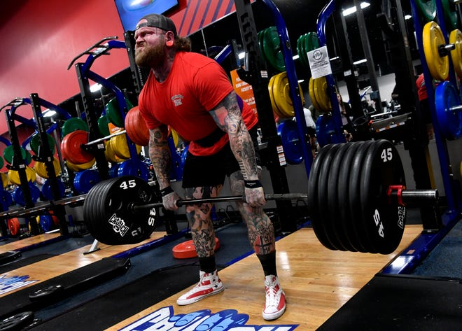 Chris Carroll dead lifts 585 pounds Saturday. Crunch Fitness was holding its second Lift Off power lifting competition.