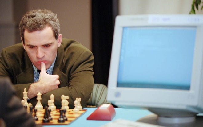 Garry Kasparov, reigning world chess champion, matches his genius against IBM's Deep Blue, the ACM international computer chess champion in the second of a six-game match Sunday, Feb, 11, 1996, in Philadelphia. Kasparov was defeated in the first game to pit human against machine for a regulation, six-game chess match.