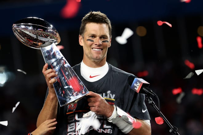 Buccaneers quarterback Tom Brady holds the Vince Lombardi Trophy following Super Bowl 55 against the Chiefs on Sunday in Tampa, Fla. Tampa Bay won, 31-9.
