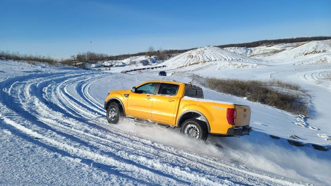 The 2021 Ford Ranger Tremor at play. It's rear-wheel-drive layout and 4x4 traction makes it fun in the snow.