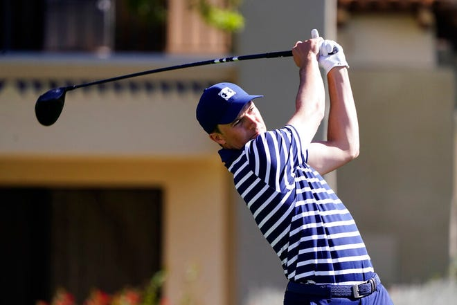 Jordan Spieth tees off on the fifth hole during the final round of a PGA golf tournament on Sunday in Scottsdale, Ariz.