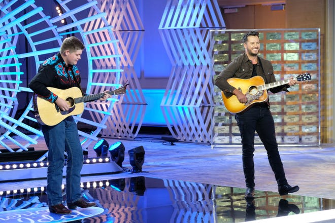 """Alex Miller of Lancaster, Ky performs with country music superstar Luke Bryan on Season 4 of ABC's """"American Idol."""""""
