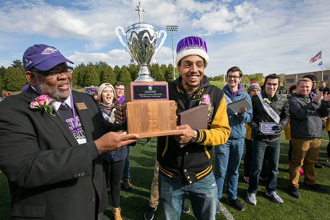 UW-Whitewater psychology major Purcell Pearson, center, was homecoming royalty and a member of Alpha Phi Alpha Fraternity, on Saturday, Oct. 12, 2019.