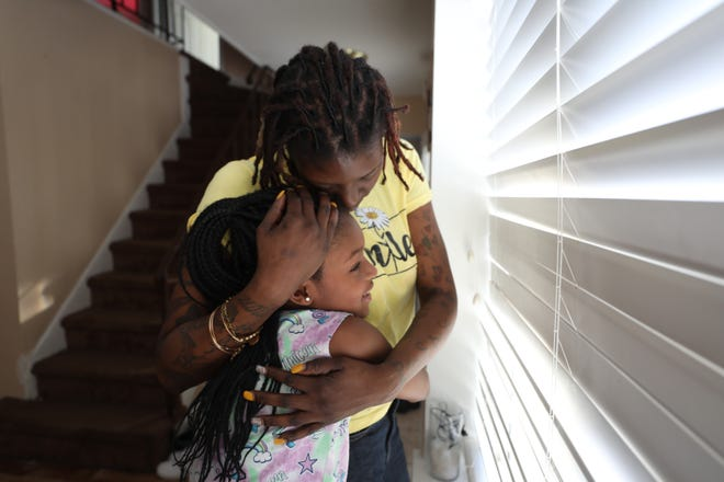 Michele Onley-Okonkwo lost her job in October and has yet to receive any unemployment compensation. She was a part-time janitor with the New Jersey Turnpike Authority. Here, she is photographed in her home with her 9-year-old daughter, Lee.