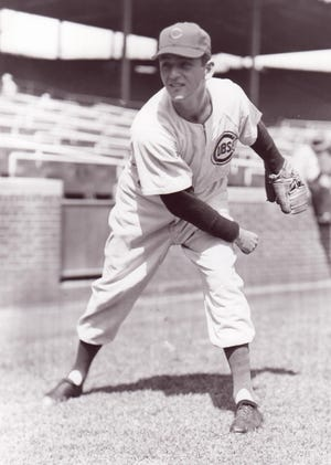 Palm Desert resident Hy Cohen, seen here with the Chicago Cubs in 1955, died Thursday in Rancho Mirage at the age of 90.