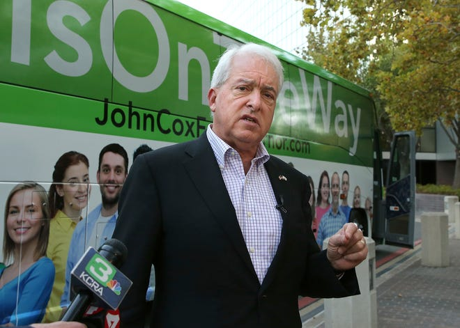 In this Nov. 1, 2018, file photo, Republican gubernatorial candidate John Cox talks to reporters before beginning a statewide bus tour in Sacramento, Calif. California Gov. Gavin Newsom is facing a possible recall election as the nation's most populous state struggles to emerge from the coronavirus crisis. Newsom's challenging year has already encouraged Republicans who have signaled they are likely candidates, including former San Diego Mayor Kevin Faulconer and Newsom's 2018 rival, businessman Cox.