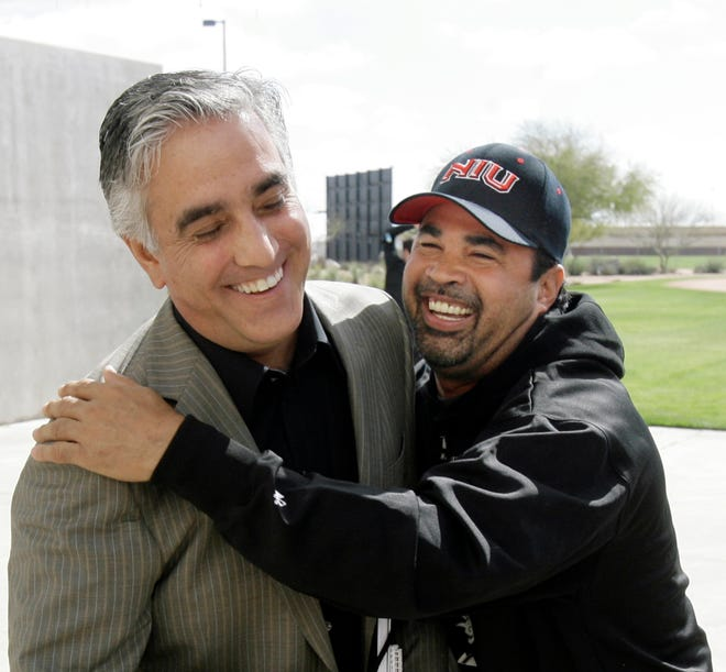 In this Saturday, Feb. 16, 2008, file photo, Chicago White Sox manager Ozzie Guillen, right, jokes with ESPN's Pedro Gomez after a news conference during the first day of baseball spring training for pitchers and catchers, in Tucson, Ariz.