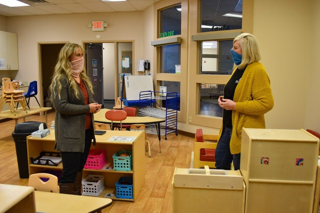 Shannon Matso, left, and Sue Benner talk in one of the Early Head Start classrooms in the Port Clinton Center. The ladies look forward to the day they can once again host play dates with their Home-Based Program children, but for now, they are still building relationships with them through virtual meetings.
