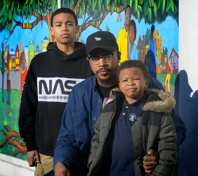 Richard Craighead and his sons Richard, 12, and Christian, 5, pose outside Voni Grimes Gym Monday, Feb. 8, 2021. Craighead was named the York NAACP president in January. Bill Kalina photo