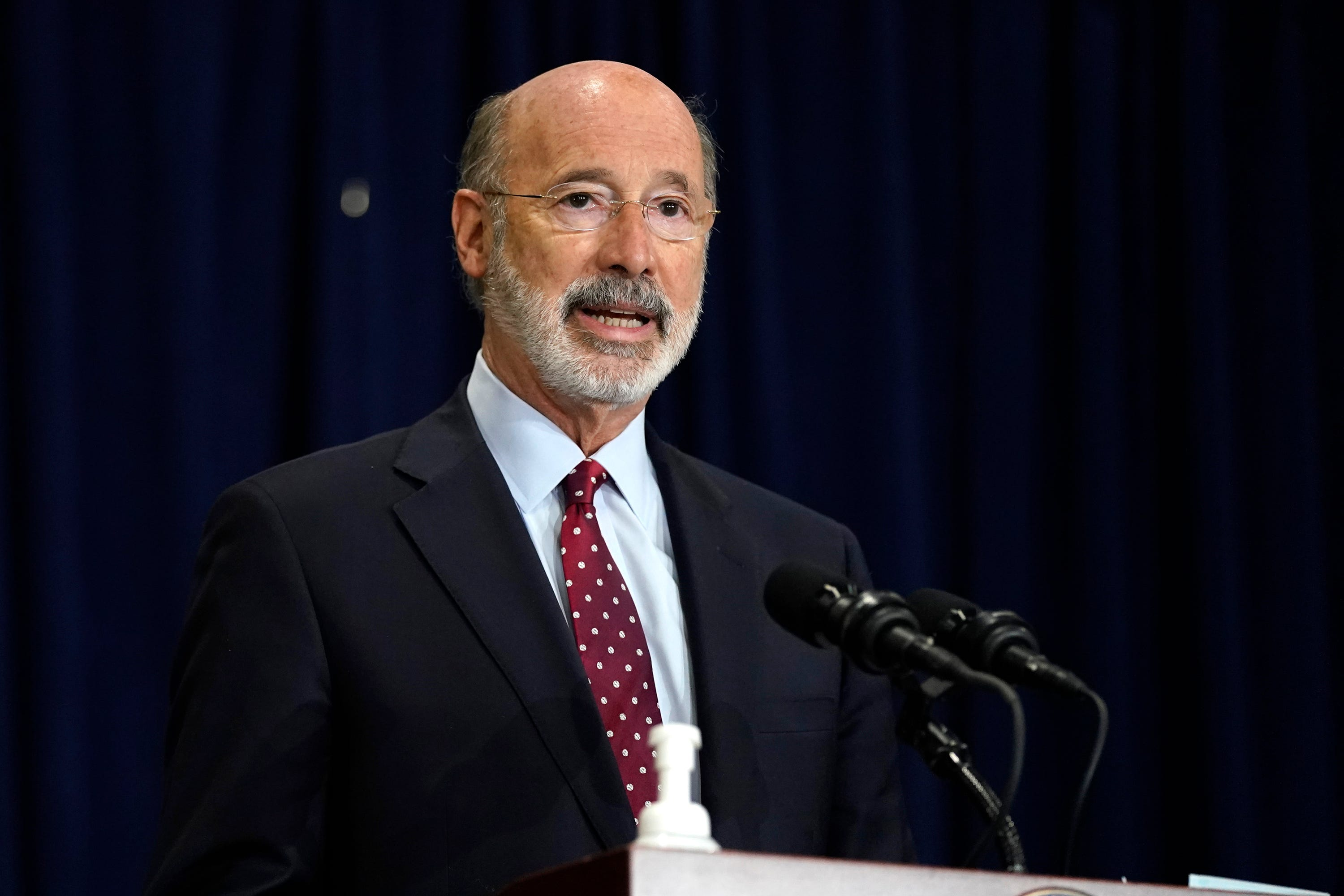 FILE - In this Nov. 4, 2020, file photo, Pennsylvania Gov. Tom Wolf speaks during a news conference in Harrisburg, Pa., regarding the counting of ballots in the 2020 general election. Facing a deep, pandemic-inflicted budget deficit, Gov. Wolf will ask lawmakers for billions of dollars funded by higher taxes on Pennsylvania's huge natural gas industry for workforce development and employment assistance to help the state recover.