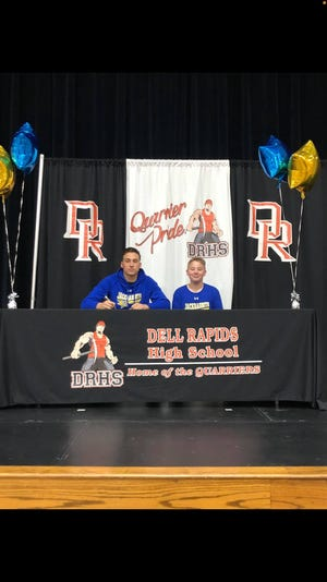 Coby Maeschen (left) sits with his brother, Carson, at National Signing Day on Wednesday, Feb. 10. Maeschen will play football at South Dakota State.