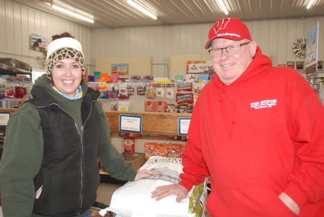 Duane Yaun, owner of Top Notch Feed & Pet Supply in New Glarus, is helped by general manager Amanda Gill who helps keep things humming along at the local business.