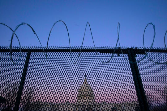 The exterior of the U.S. Capitol building is seen through barbed wire fencing at sunrise on February 8, 2021 in Washington, DC. The Senate is scheduled to begin the second impeachment trial of former President Donald J. Trump on February 9.
