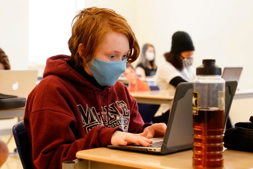 Seventh grader Trinity Cressey works on her computer at the Bruce M. Whittier Middle School, Jan. 29, 2021, in Poland, Maine.
