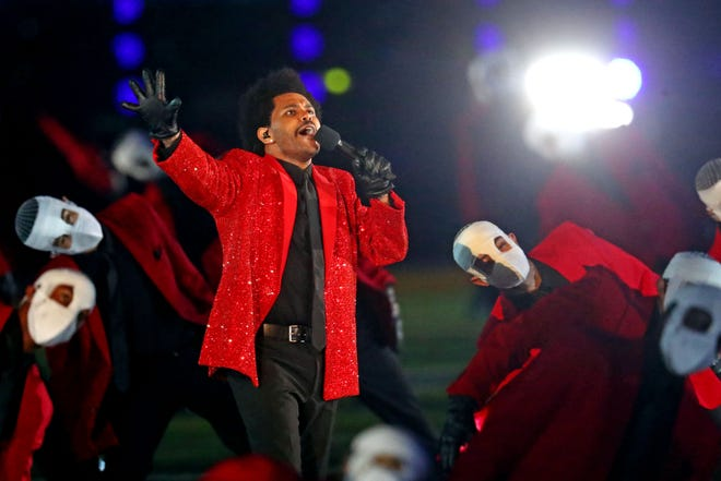 The Weeknd performs during halftime at Super Bowl LV at Raymond James Stadium, in Tampa.