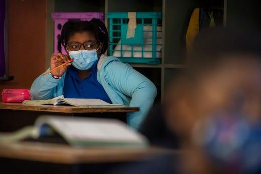 Third grader Gabriella Desrosiers, 8, listens to her teacher during class at Grassy Waters Elementary School in West Palm Beach, Fla. on Jan. 8, 2021.