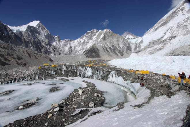 In this April 11, 2015 file photo, tents are seen set up for climbers on the Khumbu Glacier, with Mount Khumbutse, center, and Khumbu Icefall, right, seen in background, at Everest Base Camp in Nepal. The floods that slammed into two hydroelectric plants and damaged villages in northern India were set off by a break on a Himalayan glacier upstream.