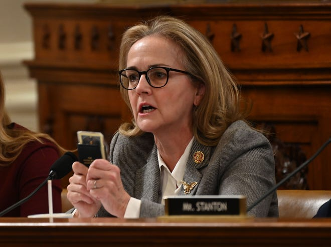 Rep. Madeleine Dean, D-Pa., holds a small copy of the U.S. Constitution as she debates a point as the House Judiciary Committee marks up articles of impeachment against President Donald Trump on Dec. 12, 2019.
