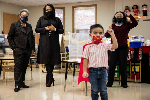 Mayor Lori Lightfoot, left, and Chicago Public Schools CEO Janice Jackson, second from left,  visit a preschool classroom at Dawes Elementary School in Chicago, Jan. 11, 2021.