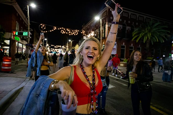 Fans celebrate in the streets of Ybor City in Tampa, Florida, after the Buccaneers beat the Chiefs in Super Bowl 55.