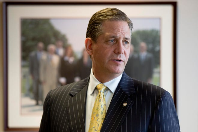 In this file photo taken July 7, 2015, a member of the Montgomery County, Pa., board of commissioners and former district attorney of the county, Bruce L. Castor Jr., speaks during an interview with The Associated Press in Norristown, Pa.