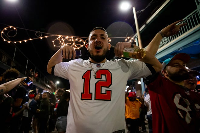 Fans celebrate in the streets of Ybor City in Tampa, Florida, after the Buccaneers defeated the Chiefs in Super Bowl 55.