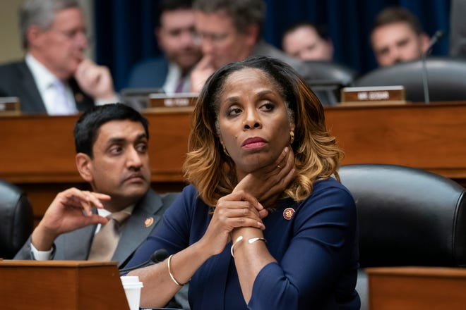 Del. Stacey Plaskett, D-Virgin Islands, joined at left by Rep. Ro Khanna, D-Calif., listen during the roll call as the House Oversight and Reform Committee votes 24-15 to hold Attorney General William Barr and Commerce Secretary Wilbur Ross in contempt for failing to turn over subpoenaed documents related to the Trump administration's decision to add a citizenship question to the 2020 census, on Capitol Hill in Washington, June 12, 2019.