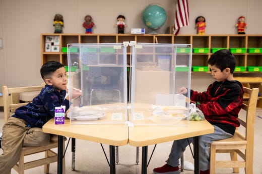 Preschool students eat lunch at Dawes Elementary in Chicago on Jan. 11, 2021.