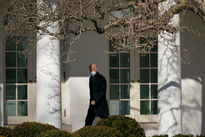 President Joe Biden walks to the Oval Office at the White House on Feb. 8, 2021, in Washington.
